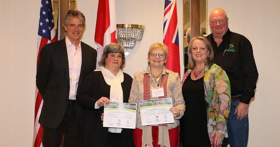One of the 150 winners: The Niagara-on-the-Lake Horticultural Society's garden tour was recognized, with certificates presented to Joanne Young (left) and Marla Percy by Alexander Reford (left) and Liz Klose (right) of the Canadian Garden Council and Bill Hardy of theCanadian Nursery Landscape Association.