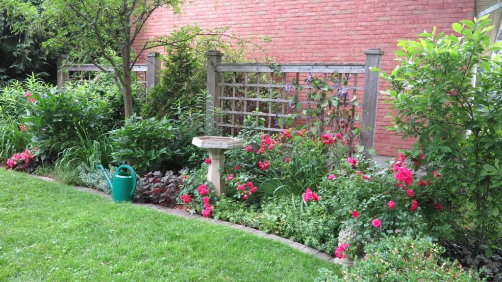 Wide planting beds are easier to design because they provide space for focal points, such as birdbaths or columnar trees. (<em>Garden Making</em> photo)