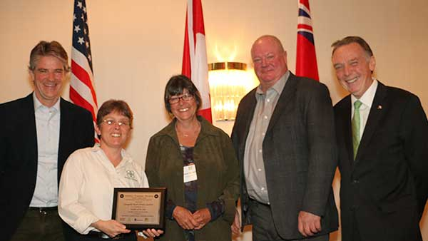 Trish Fry, manager, and Karen Achenbach, horticultural manager, receive award for Annapolis Royal Historic Gardens from Alexander Reford, Chair, Canadian Garden Council, Bill Hardy, President, Canadian Nursery Landscape Association and Peter Kent, Member of Parliament.