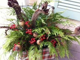 Beautiful holiday container with berries, greens, pods and curly branches. (Garden Making photo)
